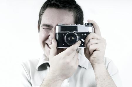 foto: Happy man with vintage photo camera.