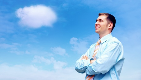Hasppiness businessman under blue sky with clouds Stock Photo - 12341157