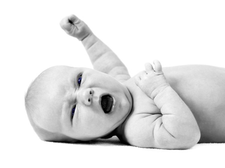 Newborn baby on the light background photo