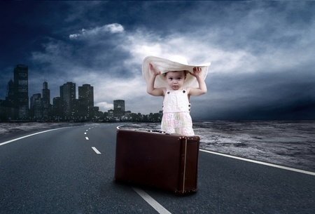 childchood: Little girl waiting on the road with her vintage baggage Stock Photo