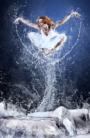 Jump of ballerina on the ice dancepool around splashes of water drops Stock Photo - 13281357