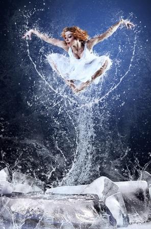 Jump of ballerina on the ice dancepool around splashes of water drops Stock Photo - 13281357