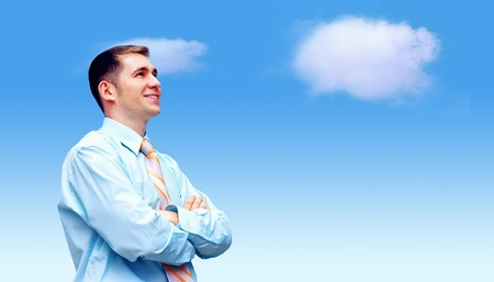 Hasppiness businessman under blue sky with clouds photo
