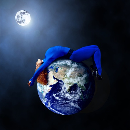 human geography: Woman in blue sleeping on the planet in space. Stock Photo