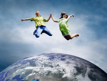 Fun couple in jump over the Planet Earth Stock Photo - 13453117