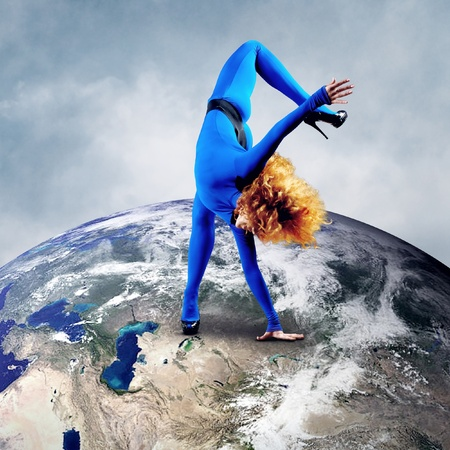 poised: Ballerina stay in dancing pose on the Planet Earth.