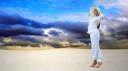 Young beautiful women in white, relaxation at sunny desert Stock Photo - 13502661