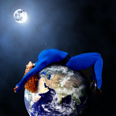 Woman in blue sleeping on the planet in space. photo