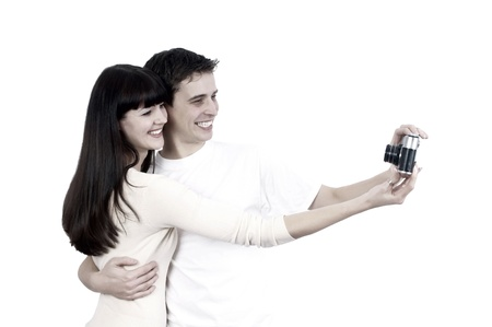 Young beauty couple with photo camera isolated on white background Stock Photo - 13610700