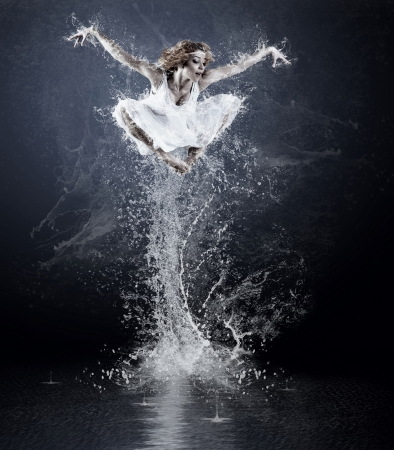 Dancers jump from water with splashes and drops Stock Photo - 13611019