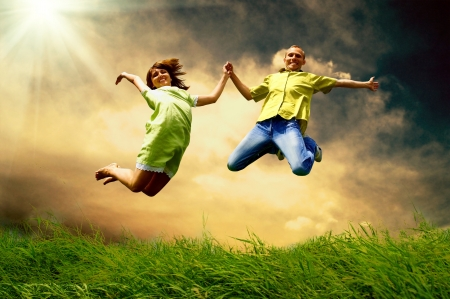 joy of life: Fun couple in jump on the outdoor background