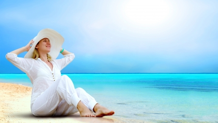 Young beautiful women in the white on the sunny tropical beach Stock Photo - 13658286