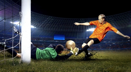 soccer goal: Football player and jump of goalkeeper on the field of stadium at night