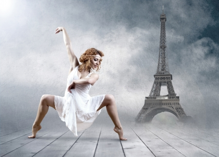 Woman dancer seating posing on the Eifel tower background photo