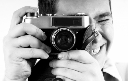 Happiness man with vintage photo camera. photo