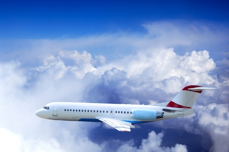 freedom fighter: Airplane at fly on the sky with clouds Stock Photo