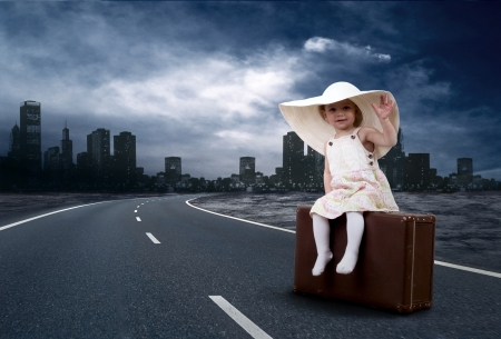 babby: Little girl waiting on the road with her vintage baggage Stock Photo