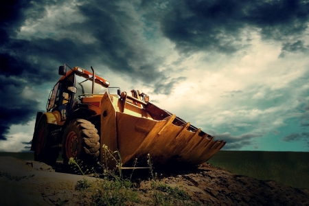 Yellow tractor on sky background Stock Photo - 13746696