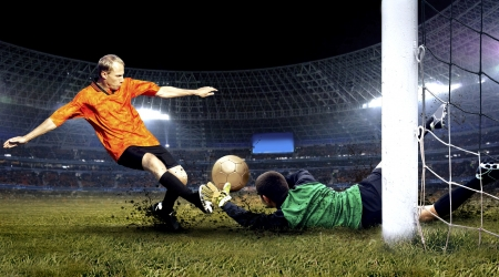 soccer ball on grass: Football player and jump of goalkeeper on the field of stadium at night