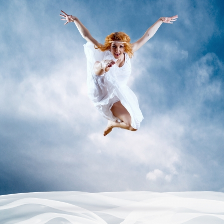 Jump of ballerina with dress of milk photo