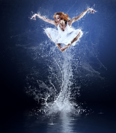 Dancers jump from water with splashes and drops Stock Photo - 14506155
