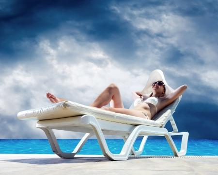 blonde bikini: Beautiful happiness girl under sun light
