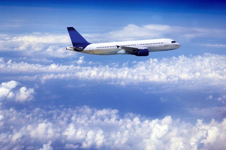 Airplane at fly on the sky with clouds photo