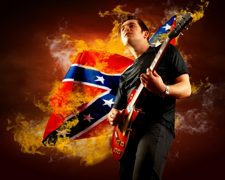 Rock guitarist play on the electric guitar around fire flames Stock Photo - 14747077