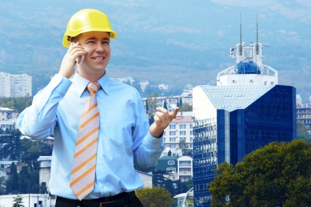 Young architect wearing a protective helmet standing on the mountains building outdoor background Stock Photo - 14747055