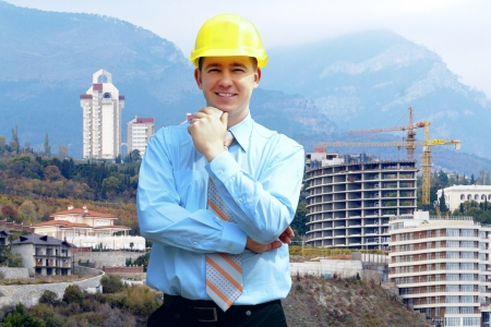 Young architect wearing a protective helmet standing on the mountains building outdoor background Stock Photo - 14747067