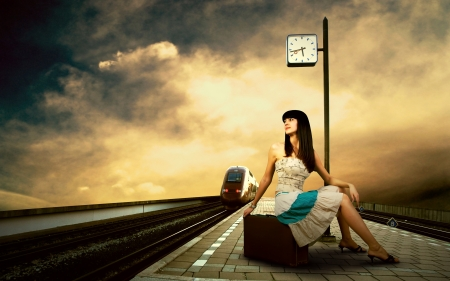 tourists stop: Girl waiting train on the platform of railway station