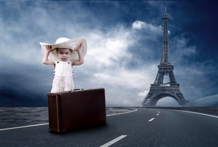 Little girl waiting on the road with her vintage baggage photo