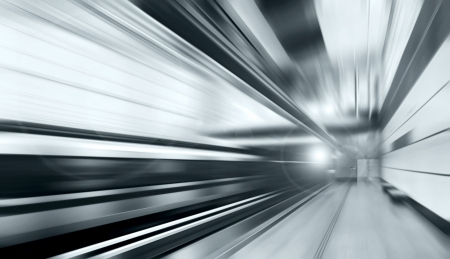 to rush: Train on speed in railway station  Stock Photo