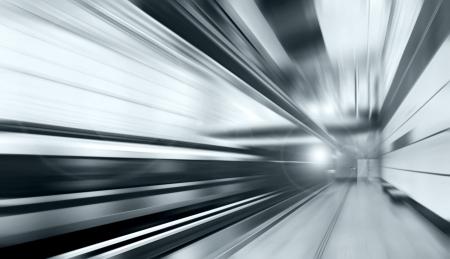 rush hour: Train on speed in railway station  Stock Photo