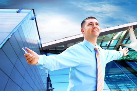 hapiness: Hapiness Businessman standing on the business background