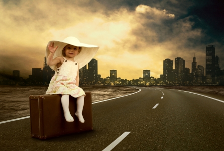 vintage children: Little girl waiting on the road with her vintage baggage Stock Photo
