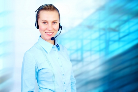 Happiness businesswoman speak in headphones on blur business architecture background Stock Photo - 15360382