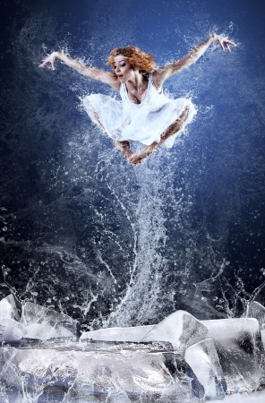 Jump of ballerina on the ice dancepool around splashes of water drops photo