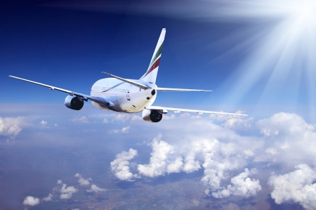 supersonic: Airplane at fly on the sky with clouds Stock Photo