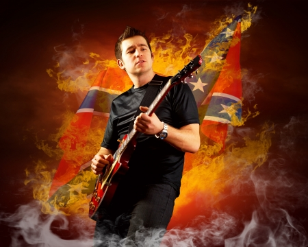 Rock guitarist play on the electric guitar around fire flames Stock Photo - 15566970