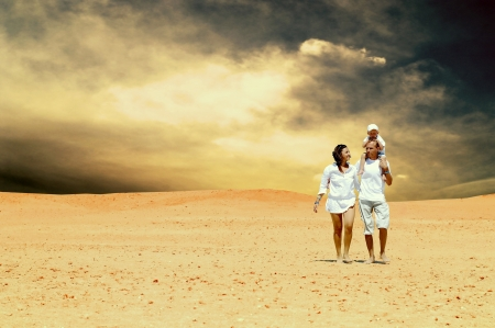 Happiness family fun in desert in sunny day photo