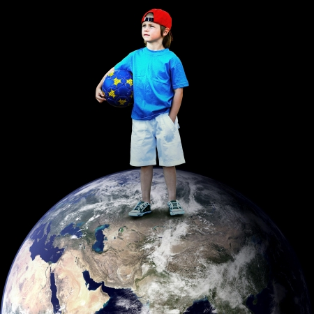 Child football player on the planet photo
