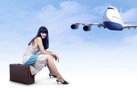 tourists stop: Young woman on the vintage baggage wait on the flying