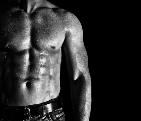 Bodybuilder posing on the black background Stock Photo
