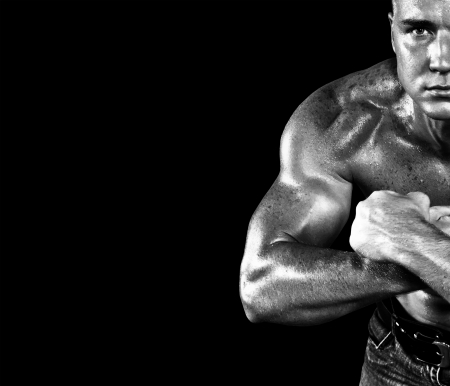 Bodybuilder posing on the black background Stock Photo - 16036173