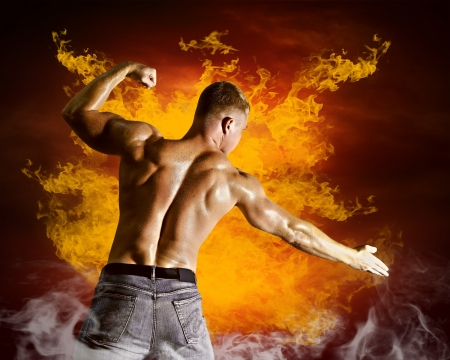 Bodybuilder posing on the fire flames background Stock Photo - 16061710