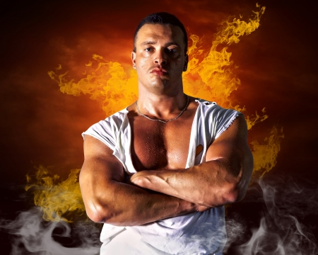 Bodybuilder posing on the fire flames background Stock Photo - 16117038