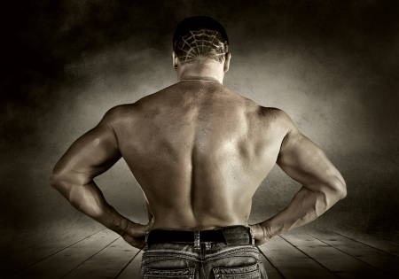 Bodybuilder posing on the outdoor grunge background Stock Photo - 16117047