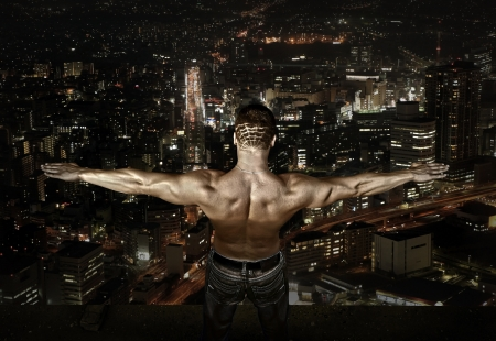 Man stay on the roof of skyscraper Stock Photo - 16192775