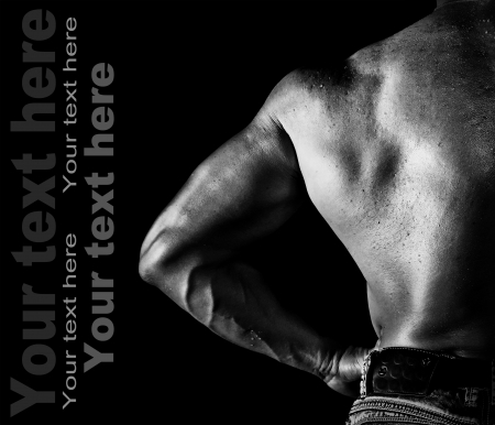 Bodybuilder posing on the black background Stock Photo - 16301486